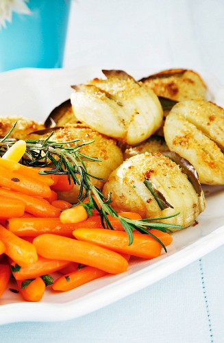 Hasselback potatoes and glazed ginger carrots