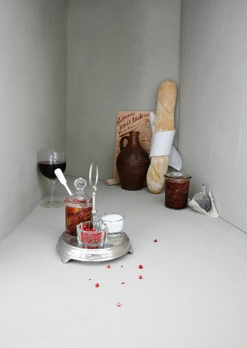 An image representing French cuisine, with a baguette and a glass of wine