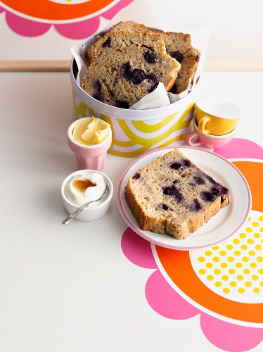 Plate of blueberry bread with butter