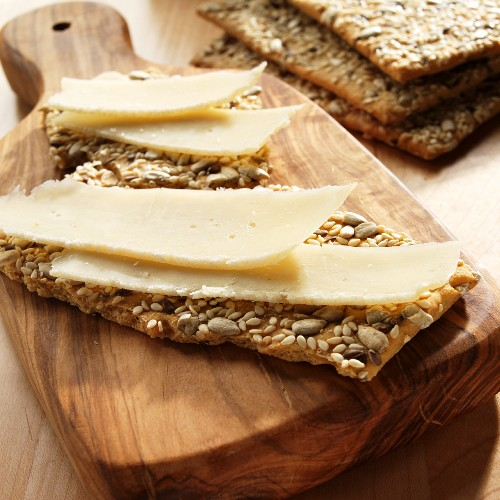 Slices of Asiago Cheese on Multi-Seed Crackers