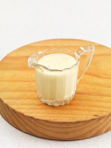 A jug of vanilla sauce