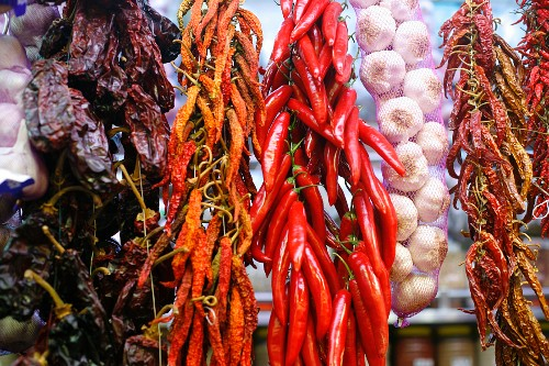 Dried Chili Peppers and Braid of Garlic at the La Boqueria Market in Barcelona, Spain