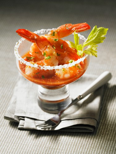 Prawn cocktail with Bloody Mary sauce in a glass with a salted rim