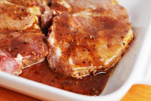 Raw Pork Chops in a Marinade