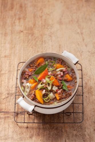 Lentil soup with diced bacon in a soup pot