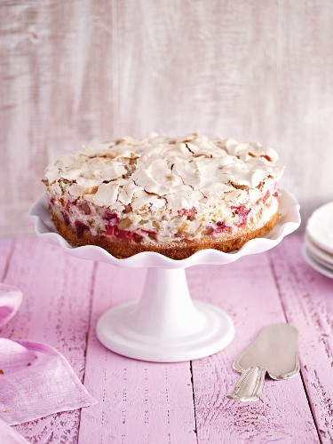 Rhubarb and meringue cake on a cake stand