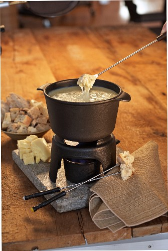 Bread Dipped into a Classic Cheese Fondue