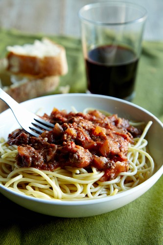 Spaghetti Topped with a Ground Buffalo Tomato Sauce; Bread and Red Wine