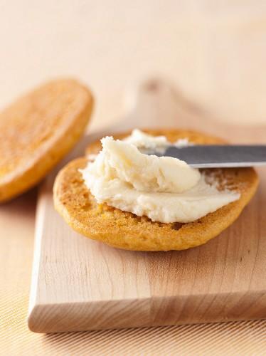 Spreading Cream Filling onto a Pumpkin Whoopie Pie