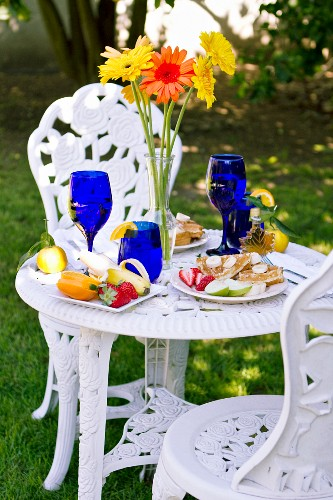 Outdoor Table Set with a Belgian Waffle Breakfast; Tall Flowers in a Vase on Table