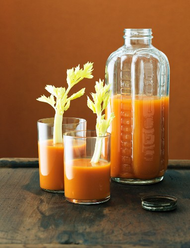 Glasses and a Jar of Carrot Juice; Glasses with Celery Stals