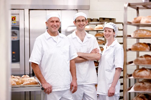 Three bakers in a bakery