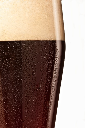 A glass of dark wheat beer