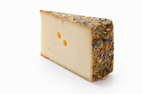 Hard cheese with meadow flowers