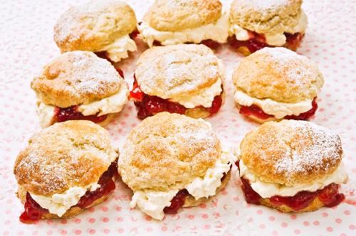 Nine scones with raspberry jam and cream