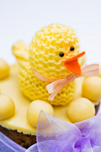 A knitted chick on a simnel cake (English Easter cake)