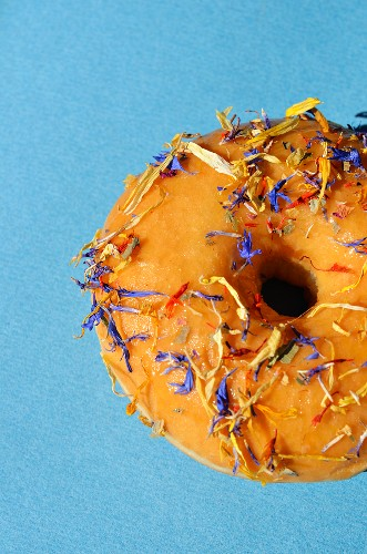 A doughnut decorated with petals