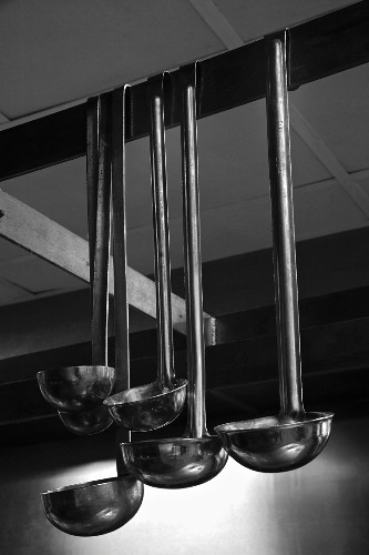 Ladles Hanging from a Rack in a Kitchen