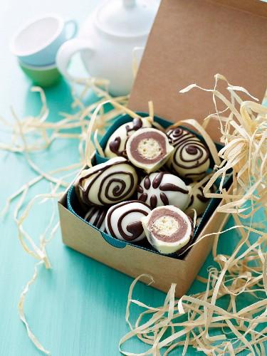 Chocolate eggs with crispy centres