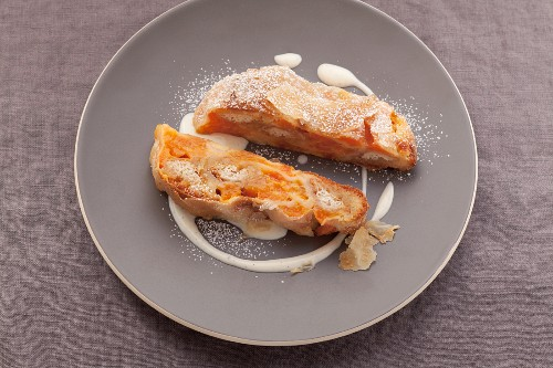 Apricot strudel on a grey plate