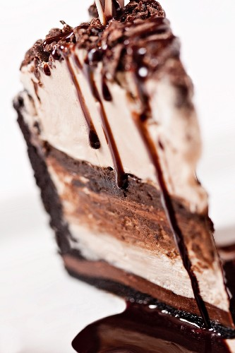 A Slice of Chocolate and Vanilla Ice Cream Cake with Chocolate Syrup