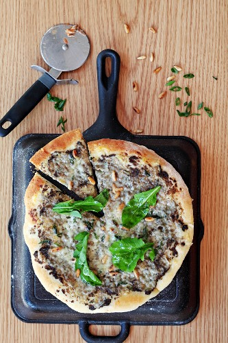 A mushroom and pine nut pizza