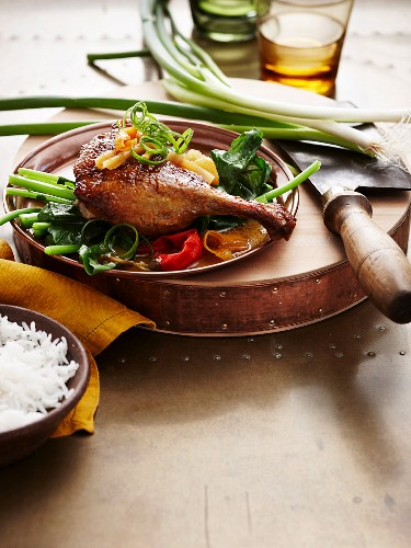 Duck leg with spring onions and rice (Asia)