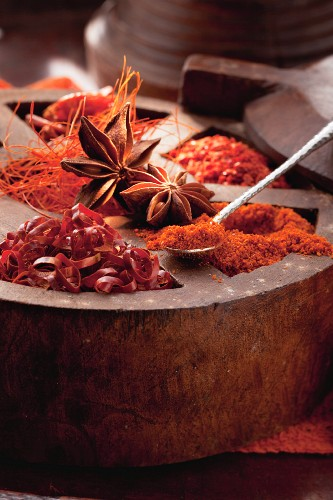 An arrangement of spices featuring dried chillis and star anise