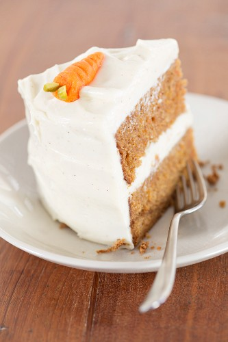 A slice of carrot cake with cream cheese frosting (USA)