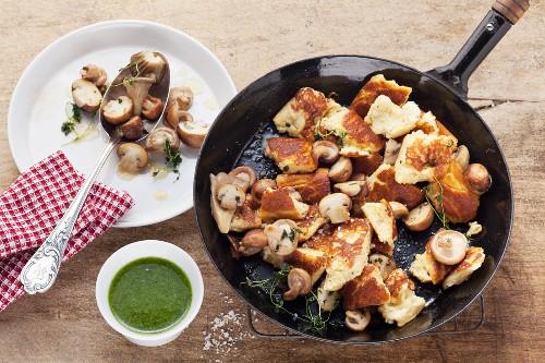 Chopped-up potato pancake with mushrooms