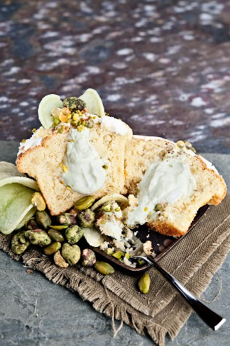 Savoury cupcake filled with cream and wasabi paste, garnished with wasabi-coated pistachios