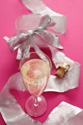 Champagne glass, champagne cork and ribbon