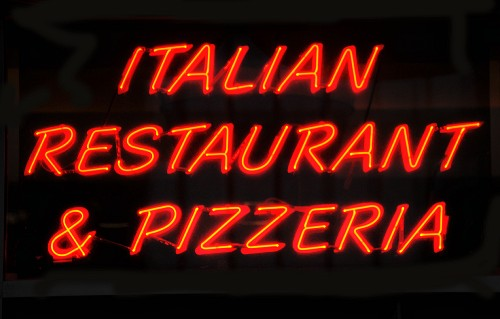A red neon sign on a pizzeria in Chicago