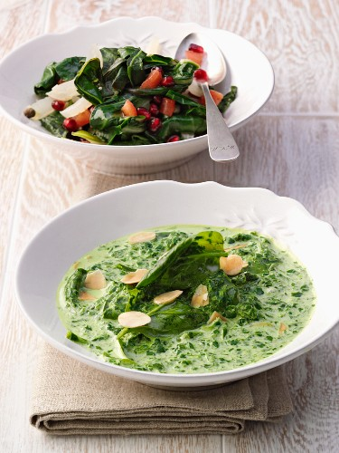 Creamed spinach with almonds, and chard with pomegranate seeds