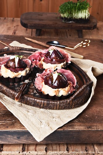 Figs cooked in cake batter with dry-cured ham and cream cheese