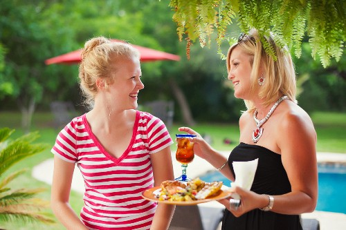 A woman and a teenage girl at a garden party