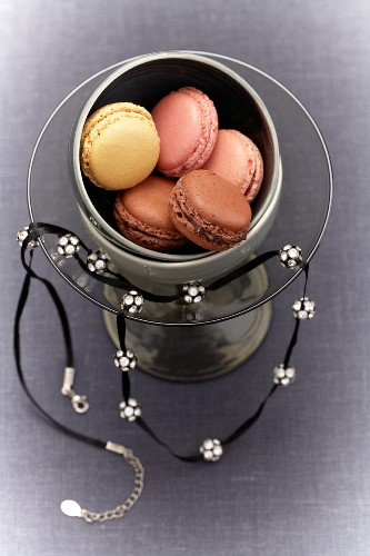 Macaroons in a glass with a necklace