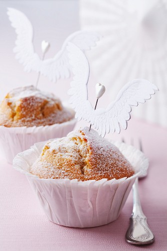Muffins decorated with icing sugar and angel's wings