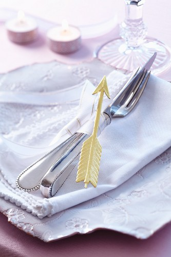 A napkin concept with a ribbon and Cupid's arrow