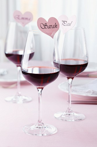 Glasses of red wine with heart-shaped name labels