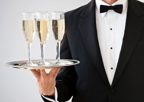 Champagne being served on a silver tray
