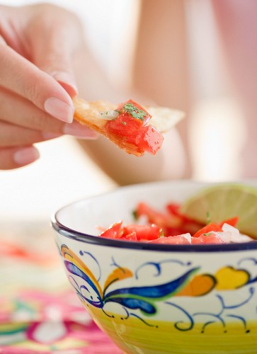 USA, New Jersey, Jersey City, Close-up view of woman's hand eating salad with cracker