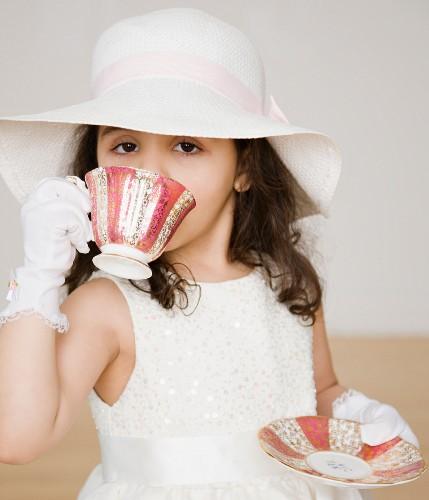 Hispanic girl dressed up at tea party