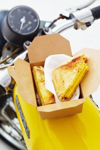 Cheese sandwiches in a cardboard box