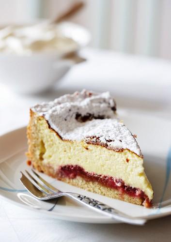A slice of strawberry and rhubarb cheesecake