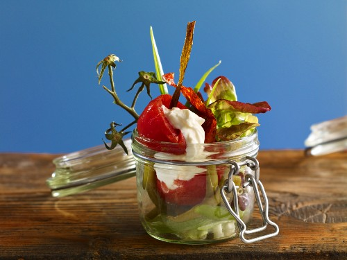 Tomato concasse with beans in a preserving jar