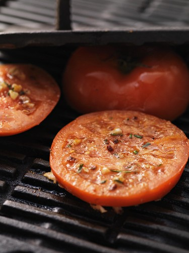 Seasoned tomatoes on the barbecue