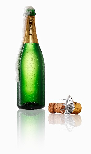 Champagne bubbling out of the bottle