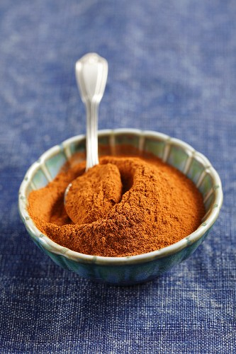 A small bowl of ground cinnamon