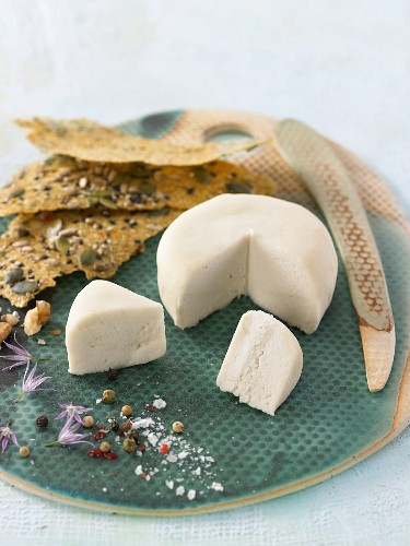Vegan macadamia nut and pecan nut cheese with crackers